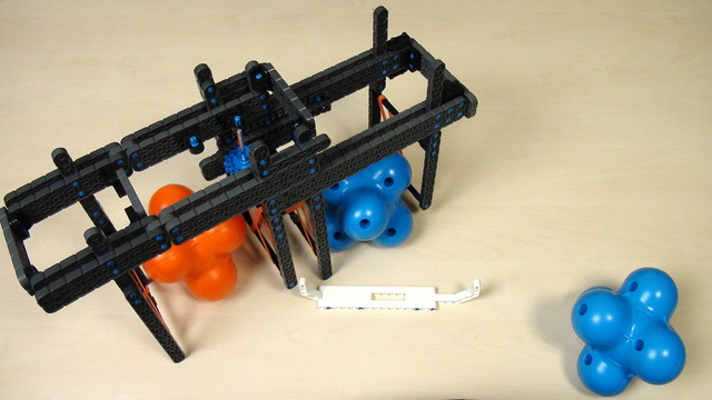 Image for VEX IQ Crossover. Teacher Note. Attaching triple attachment to a robot