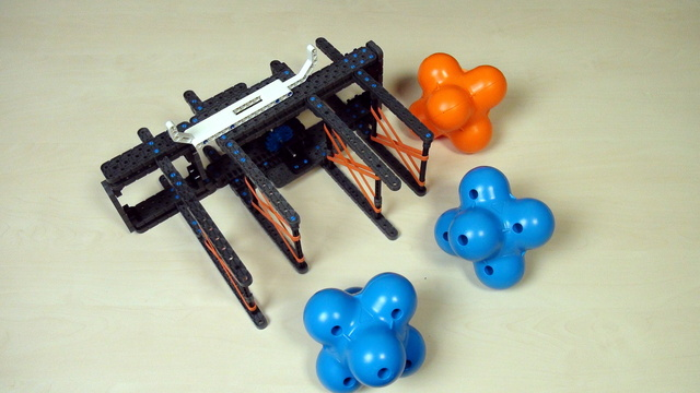 Image for VEX IQ Crossover. Introduction to extending attachment to grab a second object