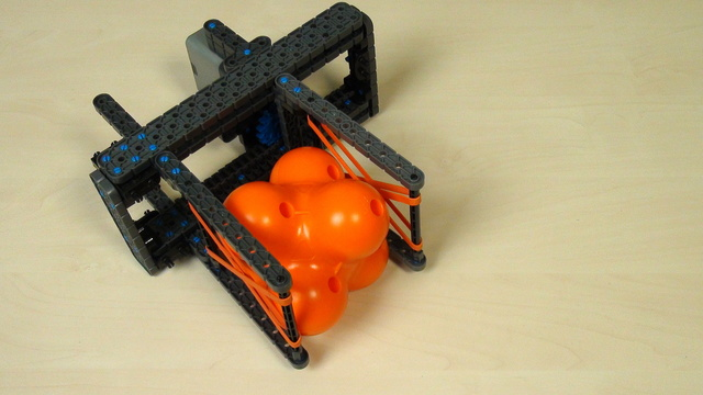 Image for VEX IQ Crossover. Task. Grab a hex ball with our attachment and with your attachment