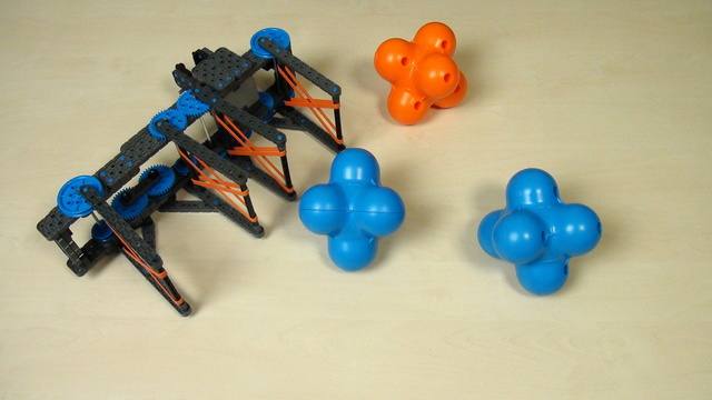 Image for VEX IQ Crossover. Two hex balls with an extended attachment. Part 1