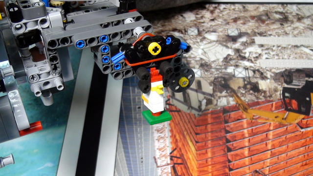 Image for Precisely dropping the chicken. FIRST LEGO League Trash Trek 2015