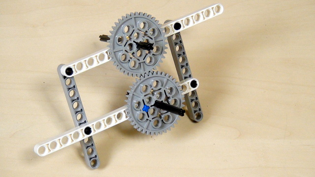 Image for Improving FLL Robot Game. Beams on all axles of the gear wheels